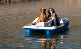 We smile for the camera. He's liking the boat.