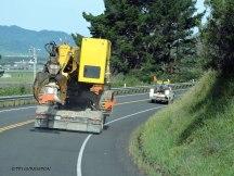 Log loader, heel boom